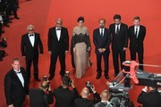 """(FromL) Iranian actor Farid Sajjadihosseini, Iranian actor Babak Karimi, Iranian actress Taraneh Alidoosti, Iranian director Asghar Farhadi, Iranian actor Shahab Hosseini and French producer and distributor Alexandre Mallet-Guy pose as they arrive on May 21, 2016 for the screening of the film """"The Salesman (Forushande)"""" at the 69th Cannes Film Festival in Cannes, southern France.  / AFP / François Xavier MARIT"""