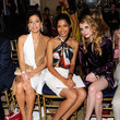 She shows off her stems with Freida Pinto and Emma Roberts.