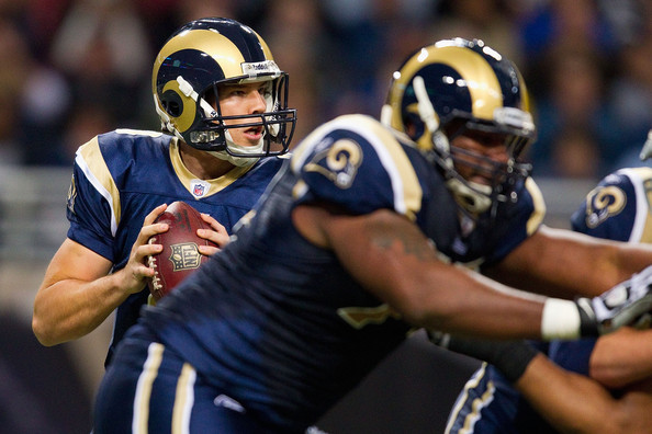 Sam Bradford, protected by Jason Smith. Photo by Dilip Vishwanat/Getty Images North America
