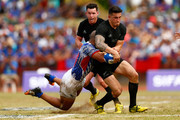 Sonny Bill Williams of the New Zealand All Blacks is tackled during the International Test match between Samoa and the New Zealand All Blacks at Apia Stadium on July 8, 2015 in Apia, Samoa.