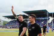 Sonny Bill Williams of the New Zealand All Blacks thanks the crowd with Daniel Carter of the New Zealand All Blacks after winning the International Test match between Samoa and the New Zealand All Blacks at Apia Stadium on July 8, 2015 in Apia, Samoa.