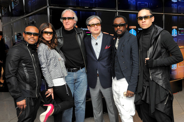 Director James Cameron and B.K. Yoon, President of Visual Display Business, Samsung Electronics (center) pose with Apl.de.Ap, Fergie, Taboo and Will.i.am of the Black Eyed Peas at the Samsung 3D LED TV launch party with THE BLACK EYED PEAS at Time Warner Center on March 10, 2010 in New York City.