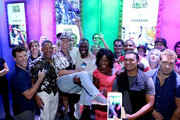 Actors Adam Beach, Joel Kinnaman, Scott Eastwood, Adewale Akinnuoye-Agbaje, Jay Hernandez, Jai Courtney, Karen Fukuhara, Viola Davis, Will Smith, and Margot Robbie of 'Suicide Squad' pose with fans during a meet and greet at the Samsung Experience at San Diego Comic-Con 2016 at Hard Rock Hotel San Diego on July 23, 2016 in San Diego, California.