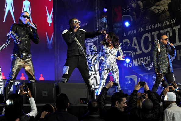 (L to R) Taboo, Will.i.am, Fergie, and Apl.de.Ap perform at the Samsung Times Square Concert with THE BLACK EYED PEAS at Times Square on March 10, 2010 in New York City.