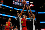 LaMarcus Aldridge #12 of the San Antonio Spurs battles for a rebound against Alex Len #25 of the Atlanta Hawks at State Farm Arena on March 06, 2019 in Atlanta, Georgia.  NOTE TO USER: User expressly acknowledges and agrees that, by downloading and or using this photograph, User is consenting to the terms and conditions of the Getty Images License Agreement.