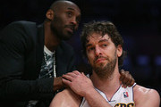 Pau Gasol #16 of the Los Angeles Lakers is consoled by Kobe Bryant after coming out of the game in the second half against the San Antonio Spurs during Game Four of the Western Conference Quarterfinals of the 2013 NBA Playoffs at Staples Center on April 28, 2013 in Los Angeles, California. The Spurs defeated the Lakers 103-82. NOTE TO USER: User expressly acknowledges and agrees that, by downloading and or using this photograph, User is consenting to the terms and conditions of the Getty Images License Agreement.  (Photo by Jeff Gross/Getty Images)thx