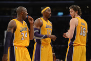 Kobe Bryant #24, Dwight Howard #12 and Pau Gasol #16 of the Los Angeles Lakers talk during the game against the San Antonio Spurs at Staples Center on November 13, 2012 in Los Angeles, California.  NOTE TO USER: User expressly acknowledges and agrees that, by downloading and or using this photograph, User is consenting to the terms and conditions of the Getty Images License Agreement.