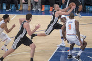 Manu Ginobili #20 of the San Antonio Spurs drives to the basket against Kyle O'Quinn #9 of the New York Knicks during the game at Madison Square Garden on January 02, 2018 in New York City. NOTE TO USER: User expressly acknowledges and agrees that, by downloading and or using this photograph, User is consenting to the terms and conditions of the Getty Images License Agreement.