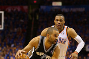 Tony Parker #9 of the San Antonio Spurs handles the ball against Russell Westbrook #0 of the Oklahoma City Thunder in the first half during Game Three of the Western Conference Finals of the 2014 NBA Playoffs at Chesapeake Energy Arena on May 25, 2014 in Oklahoma City, Oklahoma.