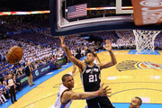 Tim Duncan #21 of the San Antonio Spurs defends Russell Westbrook #0 of the Oklahoma City Thunder in the first half during Game Four of the Western Conference Finals of the 2014 NBA Playoffs at Chesapeake Energy Arena on May 27, 2014 in Oklahoma City, Oklahoma. NOTE TO USER: User expressly acknowledges and agrees that, by downloading and or using this photograph, User is consenting to the terms and conditions of the Getty Images License Agreement.