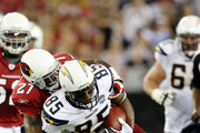 Tight End Antonio Gates #85 of the San Diego Chargers carries the ball 13 yards as he is tackled by Corner back Michael Adams #27 of the Arizona Cardinals at the University of Phoenix Stadium on August 22, 2009 in Glendale, Arizona.
