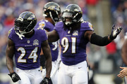 Defensive back Kyle Arrington #24 of the Baltimore Ravens and outside linebacker Courtney Upshaw #91 of the Baltimore Ravens react to a pass interference call in the second quarter of a game against the San Diego Chargers at M&T Bank Stadium on November 1, 2015 in Baltimore, Maryland.