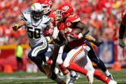 Running back Spencer Ware #32 of the Kansas City Chiefs rushes to avoid the tackle of inside linebacker Manti Te'o #50 of the San Diego Chargers during the first quarter at Arrowhead Stadium on September 11, 2016 in Kansas City, Missouri.