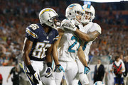 Jimmy Wilson #27 congratulates Brent Grimes #21 of the Miami Dolphins after he broke up the pass to Vincent Brown #86 of the San Diego Chargers on the final play of the game on November 17, 2013 at Sun Life Stadium in Miami Gardens, Florida. The Dolphins defeated the Chargers 20-16.