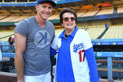 Chase Utley #26 of the Los Angeles Dodgers talks Billie Jean King who is the newest member of the team's ownership group on the field before the game against the San Diego Padres at Dodger Stadium on September 21, 2018 in Los Angeles, California. Both are alumni of Long Beach Polytechnic High School in Long Beach, California. Photo by Jayne Kamin-Oncea/Getty Images)