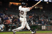 Madison Bumgarner #40 of the San Francisco Giants hits an rbi walk-off single scoring Gorkys Hernandez #7 to defeat the San Diego Padres 5-4 in 12 inning at AT&T Park on September 25, 2018 in San Francisco, California.