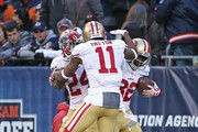 (L-R) Shaun Draughn #24, Quinton Patton #11 and Torrey Smith #82 of the San Francisco 49ers leap in celebration after Smith caught the game-winning touchdown pass against the Chicago Bears at Soldier Field on December 6, 2015 in Chicago, Illinois. The 49ers defeated the Bears 26-20 in overtime.