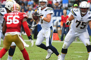 Quarterback Philip Rivers #17 of the Los Angeles Chargers gets set to throw in the second quarter of the game against the San Francisco 49ers at StubHub Center on September 30, 2018 in Carson, California.