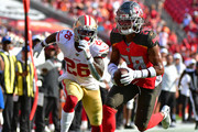 Vernon III Hargreaves #28 of the Tampa Bay Buccaneers scores a touchdown after intercepting Jimmy Garoppolo #10 of the San Francisco 49ers in the second quarter of a football game at Raymond James Stadium on September 08, 2019 in Tampa, Florida.