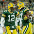 Davante Adams Photos - Aaron Rodgers #12 and Davante Adams #17 of the Green Bay Packers celebrate after scoring a touchdown in the first quarter against the San Francisco 49ers at Lambeau Field on October 15, 2018 in Green Bay, Wisconsin. - San Francisco 49ers vs. Green Bay Packers
