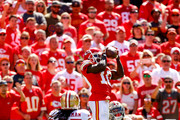 Tyreek Hill #10 of the Kansas City Chiefs leaps in the air to make a catch against Adrian Colbert #27 and Richard Sherman #25 of the San Francisco 49ers during the second quarter fo the game at Arrowhead Stadium on September 23rd, 2018 in Kansas City, Missouri.