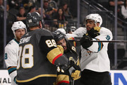 Evander Kane #9 of the San Jose Sharks corss-checks Pierre-Edouard Bellemare #41 of the Vegas Golden Knights in the third period Game One of the Western Conference Second Round during the 2018 NHL Stanley Cup Playoffs at T-Mobile Arena on April 26, 2018 in Las Vegas, Nevada. The Golden Knights defeated the Sharks 7-0.