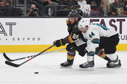 Paul Stastny #26 of the Vegas Golden Knights skates with the puck against Marc-Edouard Vlasic #44 of the San Jose Sharks in the second period of Game Six of the Western Conference First Round during the 2019 NHL Stanley Cup Playoffs at T-Mobile Arena on April 21, 2019 in Las Vegas, Nevada.