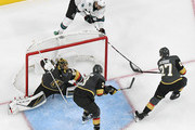 Shea Theodore #27 of the Vegas Golden Knights blocks a shot attempt by Evander Kane #9 of the San Jose Sharks as Marc-Andre Fleury #29 and Brayden McNabb #3 of the Golden Knights defend the net in the second period of Game Six of the Western Conference First Round during the 2019 NHL Stanley Cup Playoffs at T-Mobile Arena on April 21, 2019 in Las Vegas, Nevada. The Sharks defeated the Golden Knights 2-1 in double overtime to even the series at 3-3.