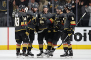 James Neal #18 (second from left) of the Vegas Golden Knights celebrates with Nate Schmidt #88, Erik Haula #56, David Perron #57 and Colin Miller #6 after scoring a power play goal against the San Jose Sharks in the third period Game One of the Western Conference Second Round during the 2018 NHL Stanley Cup Playoffs at T-Mobile Arena on April 26, 2018 in Las Vegas, Nevada. The Golden Knights defeated the Sharks 7-0.