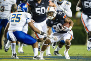 Running back Corey Grant #20 of the Auburn Tigers looks to maneuver past safety Akeem King #25 of the San Jose State Spartans on September 6, 2014 at Jordan-Hare Stadium in Auburn, Alabama. Auburn defeated San Jose State 59-13.