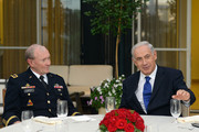 In this handout provided by the Israeli Government Press Office (GPO), Israeli Prime Minister Benjamin Netanyahu (R) meets with Gen. Martin E. Dempsey, Chairman, Joint Chiefs of Staff, at the Prime Minister's residence August 13, 2013 in Jerusalem, Israel. Gen. Dempsey is on a week-long trip to the Middle East to discuss additional U.S. support to Israel and Jordan in the face of conflict in neighboring Syria.