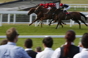 Paul Hanagan riding Karraar (R, black) win The racing.com/daypass Handicap Stakes from Tom Hark (L) at Sandown racecourse on July 03, 2015 in Esher, England.