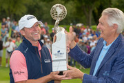 Steve Stricker of Madison, WI takes receives the trophy from Andy North as he celebrates winning the Sanford International at Minnehaha Country Club on September 23, 2018 in Sioux Falls, South Dakota.