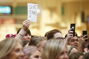 A fan holds up a sign as Sarah Jessica Parker attends Highpoint Shopping Centre on October 23, 2019 in Melbourne, Australia.