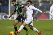 Francesco Magnanelli of US Sassuolo Calcio competes for the ball with Giuseppe Rossi of ACF Fiorentina during the Serie A match between US Sassuolo Calcio and ACF Fiorentina at Mapei Stadium - Città del Tricolore on November 30, 2015 in Reggio nell'Emilia, Italy.