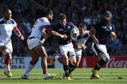 Peter Horne of Scotland is tackled by Thretton Palamo of the United States during the 2015 Rugby World Cup Pool B match between Scotland and USA at Elland Road on September 27, 2015 in Leeds, United Kingdom.