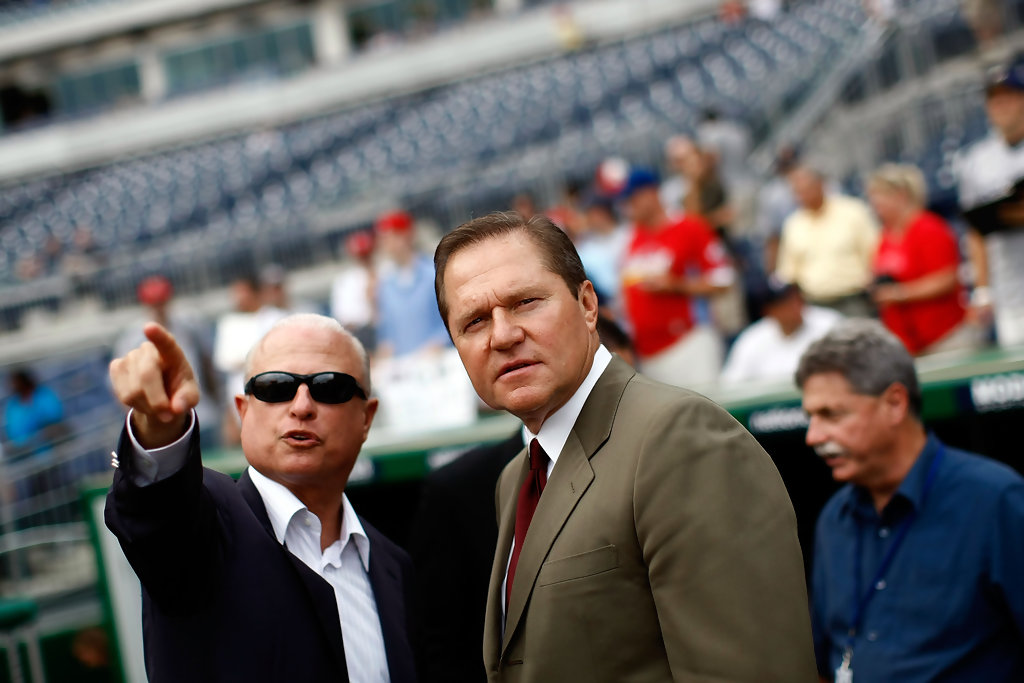 Sports agent Scott Boras (R) talks with Washington Nationals principal owner Mark Lerner (L) during pregame warmups at Nationals Park August 21, 2009 in Washington, DC. Boras represents Stephen Strasburg, a right handed pitcher from San Diego State University and the overall first round pick in the 2009 Major League Baseball draft, who signed with the Nationals earlier this week wth a record contract for an amateur player.