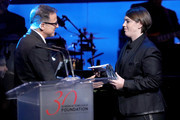 Honoree Megan Ellison receives the Patron of the Artists Awards from filmmaker David O. Rusell onstage during the Screen Actors Guild Foundation 30th Anniversary Celebration at Wallis Annenberg Center for the Performing Arts on November 5, 2015 in Beverly Hills, California.
