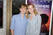 Actors Graham Patrick Martin and Ginny Gardner arrive at the LA opening night screening of Logolite Entertainment & Screen Media Films' 'Somewhere Slow' at Arena Cinema Hollywood on January 31, 2014 in Hollywood, California.