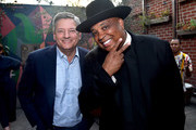 """Ted Sarandos and Rev Run attend the after party for a screening of Netflix's """"All About The Washingtons"""" on August 8, 2018 in Hollywood, California."""