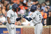 Denard Span #4 of the Seattle Mariners celebrates hitting a solo home run in the sixth inning with Guillermo Heredia #5 during a baseball game against the Baltimore Orioles at Oriole Park at Camden Yards on June 25, 2018 in Baltimore, Maryland.