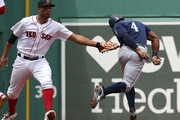 Xander Bogaerts #2 of the Boston Red Sox tags out Denard Span #4 of the Seattle Mariners who was caught off of first base in the third inning at Fenway Park on June 24, 2018 in Boston, Massachusetts.