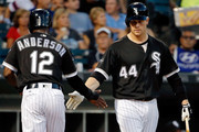 Tim Anderson #12 of the Chicago White Sox is congratulated by Justin Morneau #44 (R) ater scoring on an RBI single by Avisail Garcia #26 (not pictured) during the first inning at U.S. Cellular Field on August 25, 2016 in Chicago, Illinois.