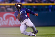 Denard Span #4 of the Seattle Mariners makes a sliding catch of a short fly ball in the fourth inning of a game against the Colorado Rockies at Coors Field on July 13, 2018 in Denver, Colorado.