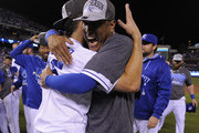 Eric Hosmer #35 and Salvador Perez #13 of the Kansas City Royals celebrate after the Royals clinched  the American League Central Division title at Kauffman Stadium on September 24, 2015 in Kansas City, Missouri.
