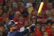 Nelson Cruz #23 of the Seattle Mariner hits a three run home run in the fourth inning of the game against the Los Angeles Angels of Anaheim at Angel Stadium on September 13, 2018 in Anaheim, California.