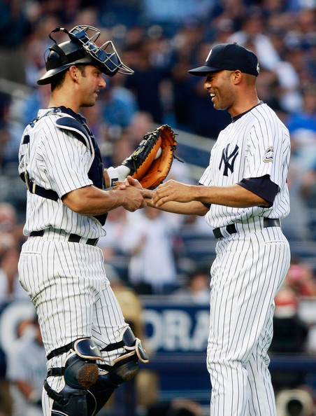 Mariano Rivera Relief pitcher Mariano Rivera #42 of the New York Yankees shakes hands with catcher Jorge Posada #20 after throwing out the ceremonial first pitch in a game against the Seattle Mariners June 30, 2009 at Yankee Stadium in the Bronx borough of New York City.
