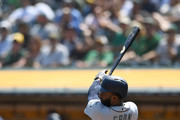 Denard Span #4 of the Seattle Mariners hits a double against the Oakland Athletics in the top of the first inning at Oakland Alameda Coliseum on September 2, 2018 in Oakland, California.