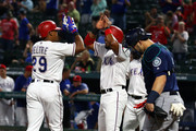 Adrian Beltre #29 is greeted by Elvis Andrus #1 of the Texas Rangers at home plate after a three-run home run agaisnt the Seattle Mariners in the first inning at Globe Life Park in Arlington on September 21, 2018 in Arlington, Texas.