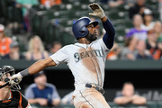 Denard Span #4 of the Seattle Mariners drives in the winning run with a sacrifice fly in the eleventh inning against the Baltimore Orioles at Oriole Park at Camden Yards on June 27, 2018 in Baltimore, Maryland.